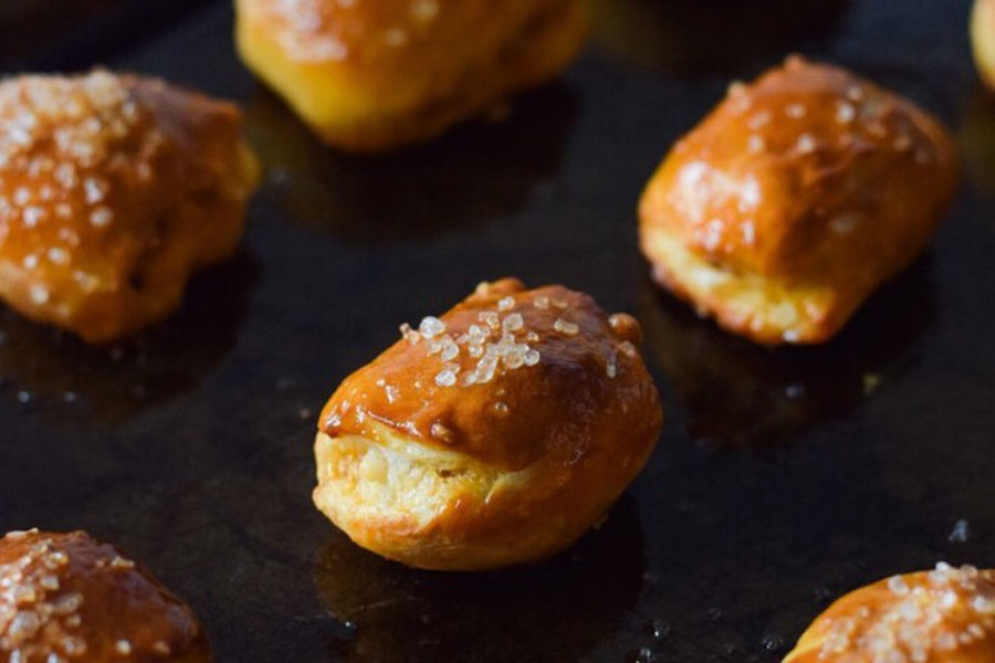 Get ready for a unique recipe that's a bite-sized surprise! This dish combines the incredible flavors of chorizo with the creamy taste of cotija cheese wrapped in a homemade mini pretzel.